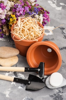 Gardening tools and clay terracotta flower pots
