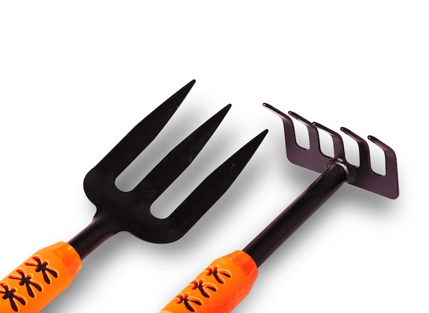 Gardening tools, cut out on white surface