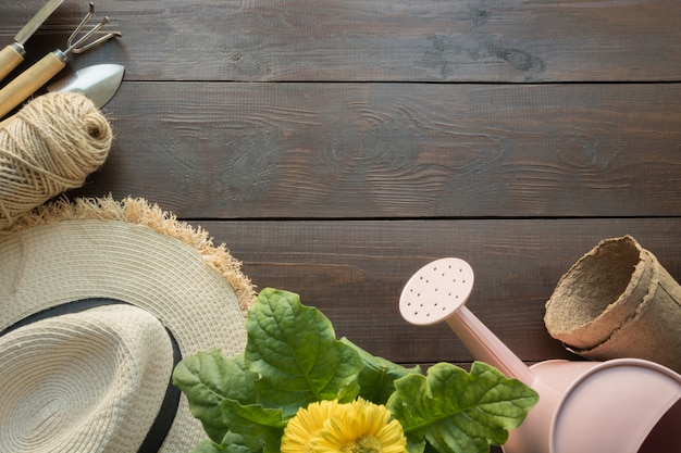 Gardening tools, flowers and soil on wooden table. spring and work in the garden.