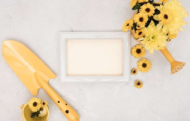 Gardening tools and flowers with empty frame