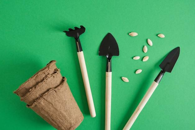 Gardening tools on green background. garedeining concept