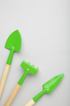 Gardening tools on grey surface with copy space