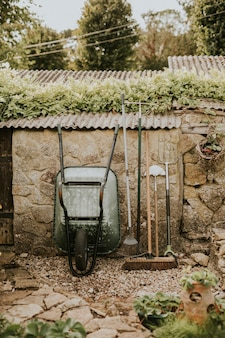 Gardening tools leaning on a shed