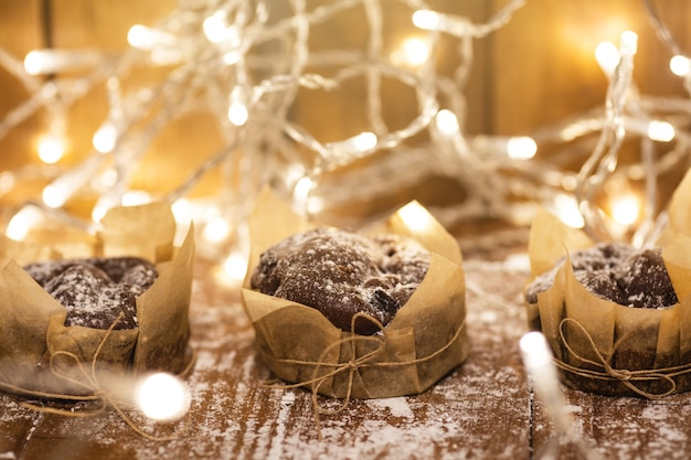 Garladn light and tasty chocolate muffins on the wooden table