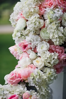 Garland of pink and white roses and peonies