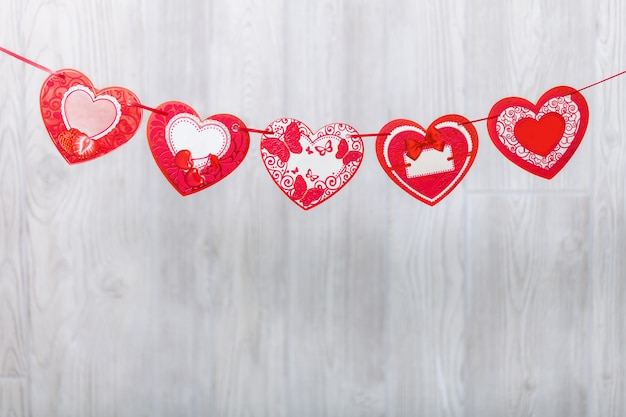 Garland of paper hearts. greeting stretching.