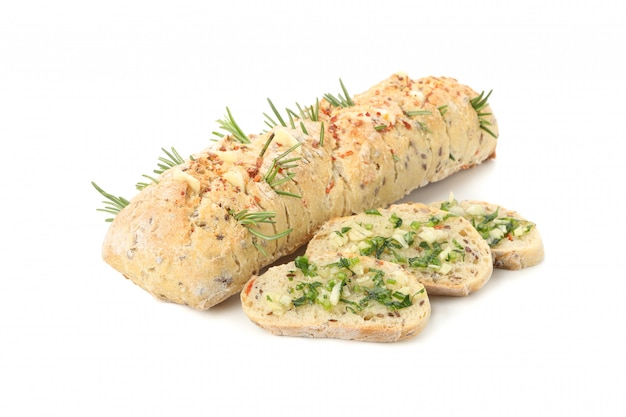 Garlic bread with spices isolated on white