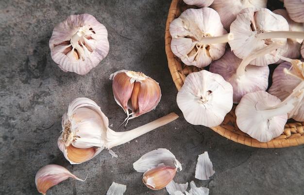 Garlic bulbs on the stone background.
