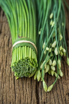 Garlic chives on wood