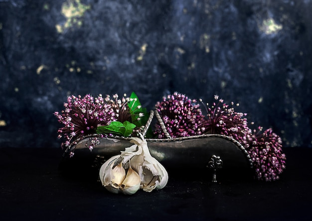 Garlic cloves and allium flowers