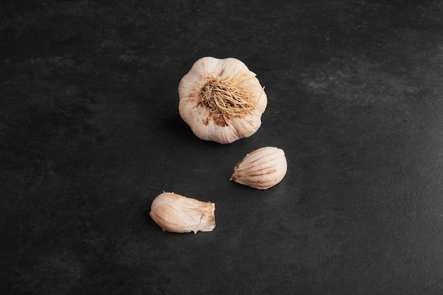 Garlic cloves isolated on black background.