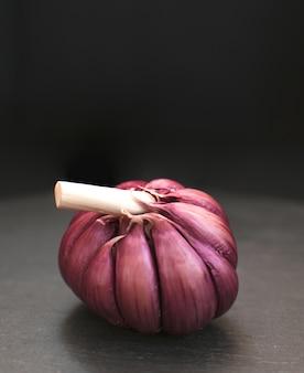 Garlic. Fresh Garlic. Cloves of garlic on black background