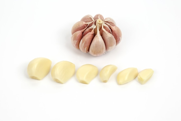 Garlic head and cloves on white