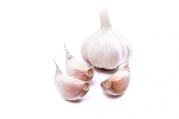 Garlic is a native spice used in cooking, images isolated on white background.