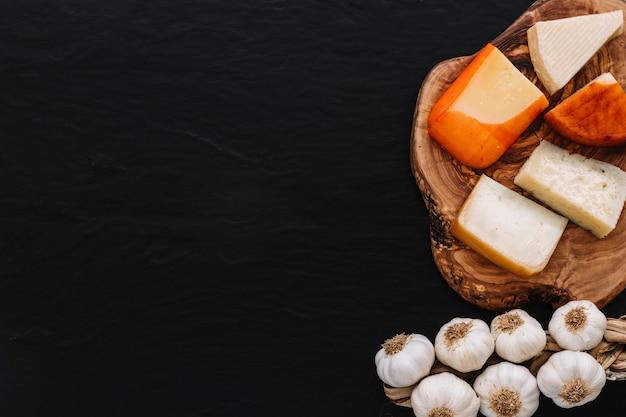 Garlic near cut cheese