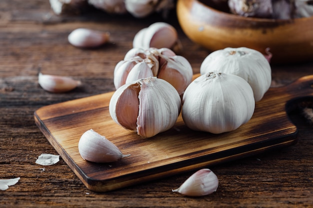 Garlic on old wooden table background