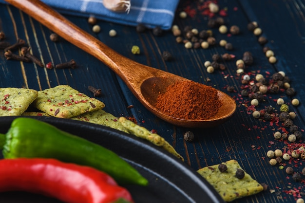 Garlic pepper paprika on a wooden spoon and spices