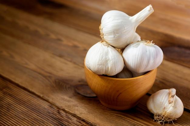Garlic in a wooden bowl in the kitchen
