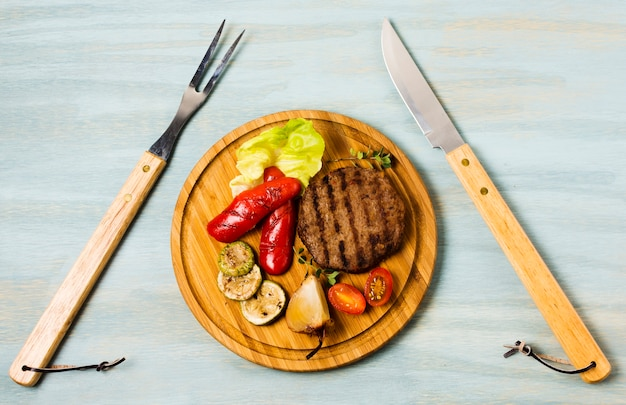 Garnished steak serving with cutlery