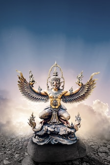 Garuda statue isolated on clouds and sky background