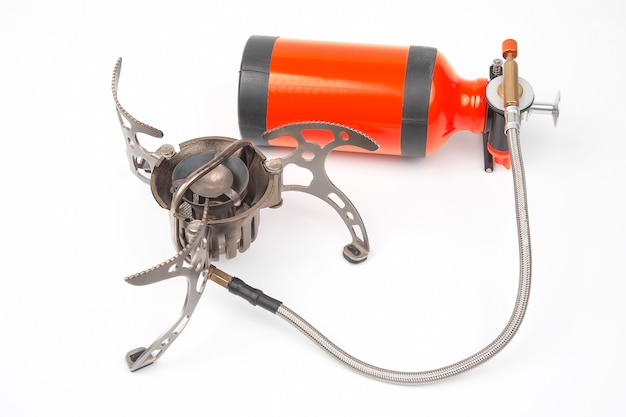 Gas and petrol tourist burner on a white
