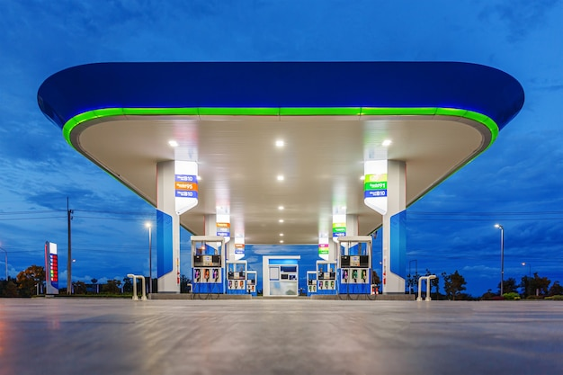 Gas station in blue night sky