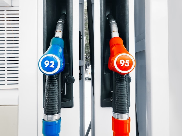 Gas station pump with two hoses  red and blue nozzles