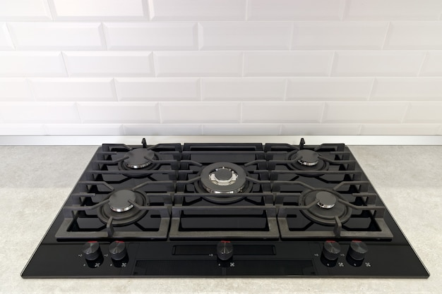 Gas stove in the kitchen is installed in the countertop.