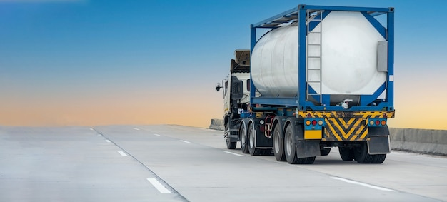 Gas truck on highway road with tank oil  container, transportation concept.,import,export logistic industrial transporting land transport on the expressway with blue sky.image motion blur
