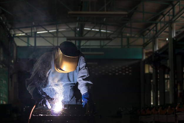 Gas welding with workpiece steel.working person in factory industry.