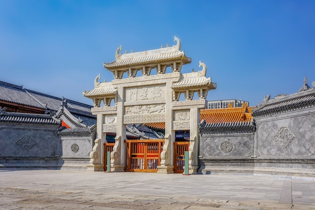 The gate of the chinese stone archway in the ancient city of jimo, qingdao