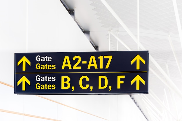 Gate label with arrow in terminal of airport