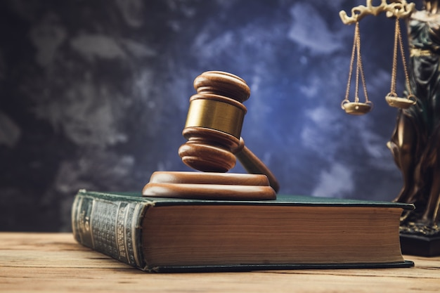 Gavel on books with the statue of justice symbol. legal law concept