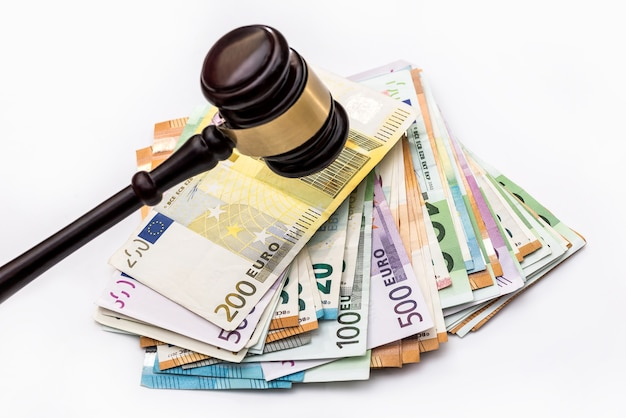 Gavel on euro banknotes isolated on white