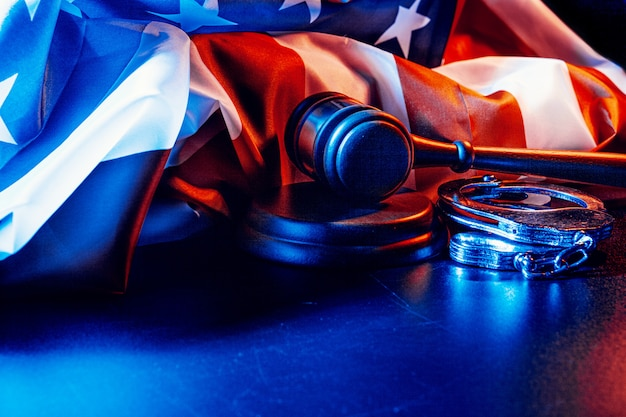 Gavel, handcuffs and american flag