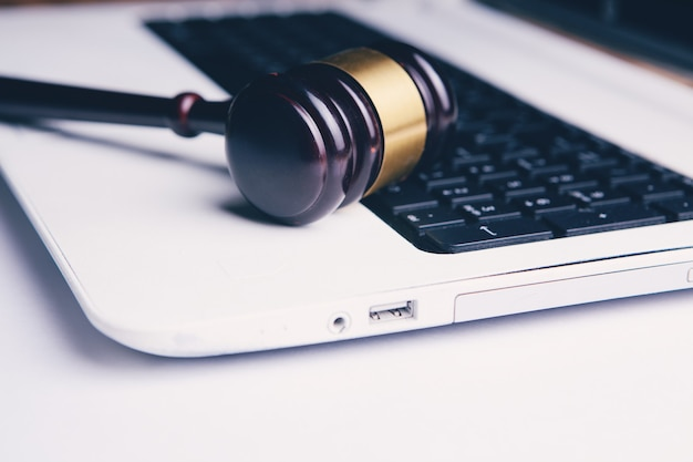 Gavel of the judge on the laptop. cybercrime