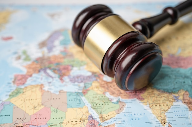 Gavel for judge lawyer on wold map.
