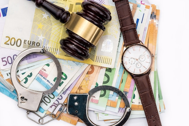 Gavel judge with handcuffs, clock on euro