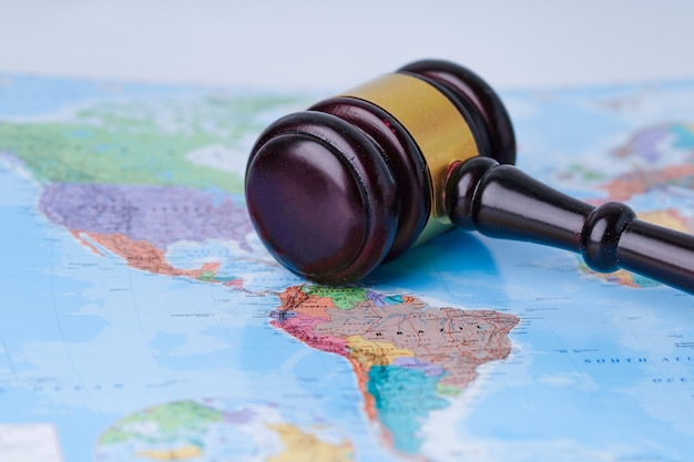 Gavel for judge on wold globe map