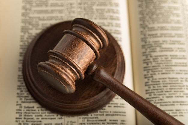 Gavel judgement and holy book of justice. law books. symbol of justice and trial. close up.