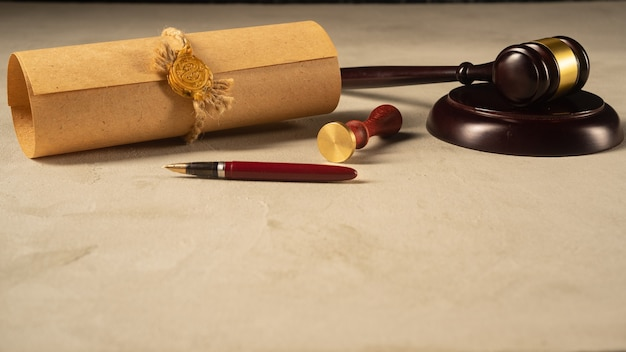 Gavel notary's public pen and stamp on testament and last wills