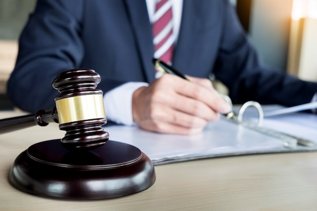 Gavel and soundblock fo justice law and lawyer working on wooden desk background