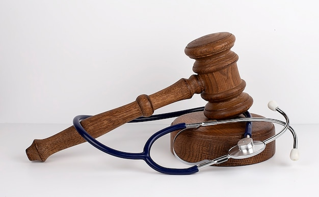 Gavel and stethoscope on the white background, medical concept