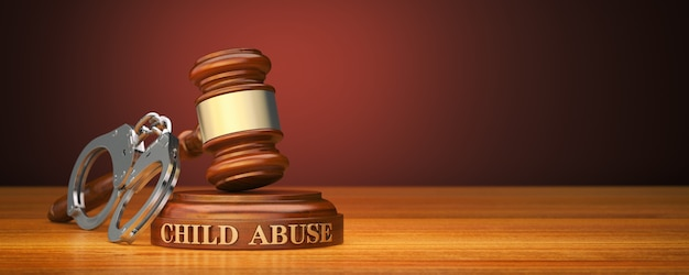 Gavel and word child abuse on sound block