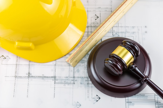 Gavel and yellow safety helmet