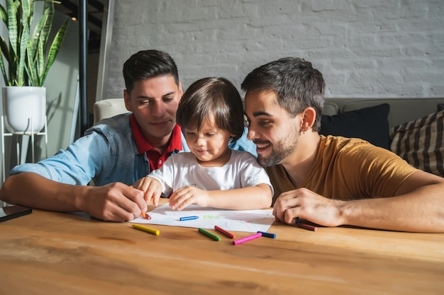 Gay couple having fun with their son at home.