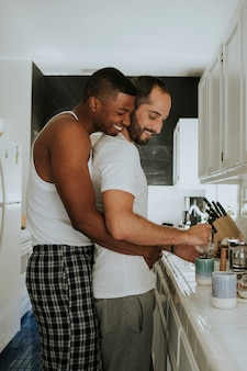 Gay couple hugging in the kitchen