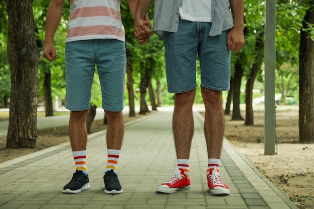 Gay couple in lgbt socks standing together outdoor