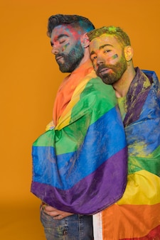 Gay couple in rainbow powder