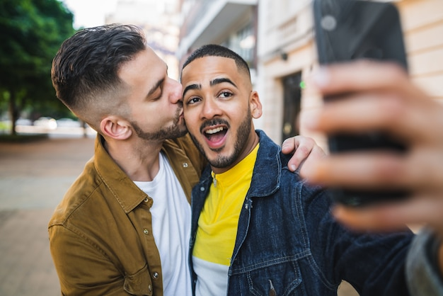 Gay couple taking a selfie in the street
